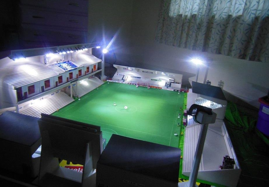 A hand-built Subbuteo stadium with a stunning Main Stand