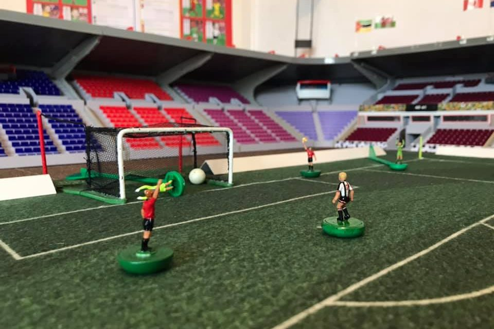 A remarkable Subbuteo stadium with colourful seating