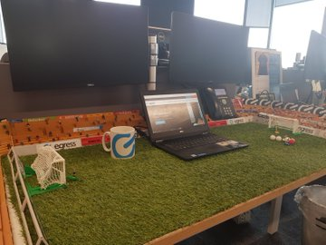 Man builds a Subbuteo stadium on his work desk – and his employer loves it