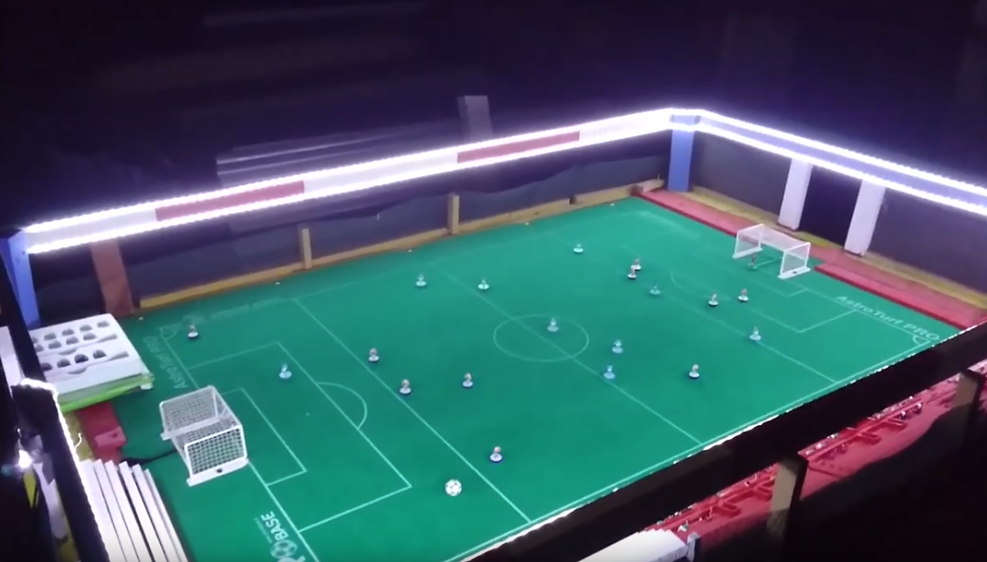 A Subbuteo stadium with a clever working floodlight design